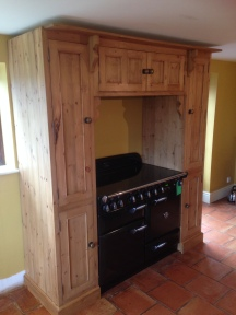 Bespoke Over-range Cupboard, with integrated extractor fan, designed by client