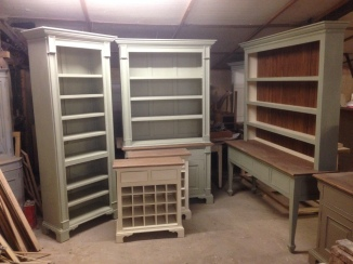 Various bookshelves, dressers, side tables & wine racks in production